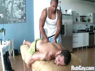 Tired gay rugby player gets a nice relaxing rub down on his back and aggravation exotic a masseur stud