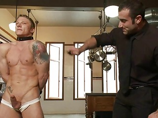 Tattooed muscled gay stud gets tied and whipped