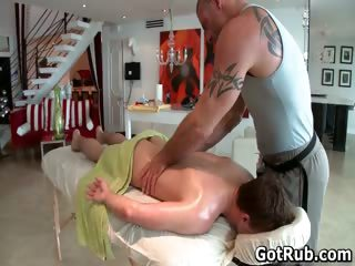 Hunky guy gets oiled up with an increment of gay massaged