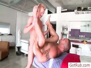 Muscled guy getting his dick rubbed