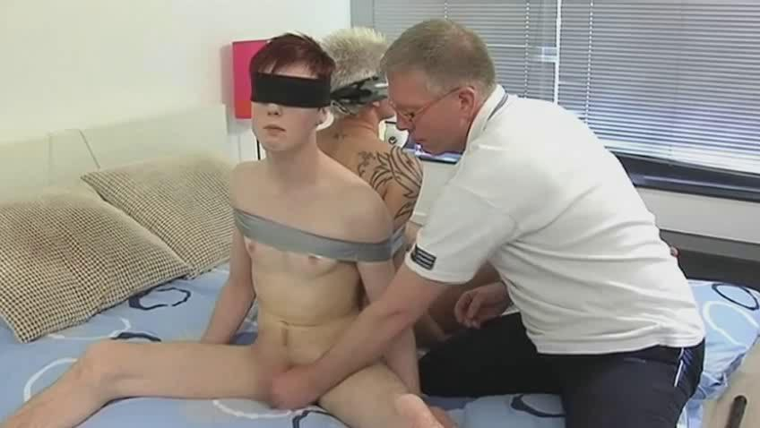 Mature gay pop handcuffs two sex-mad twinks and suck their dicks