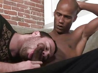 Horny gay Ryan Starr seduces a ebony cock