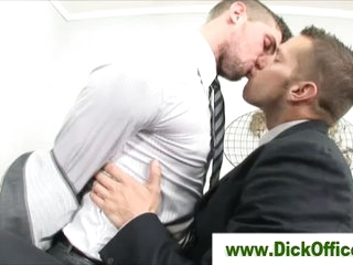 Four gay businessmen french kissing