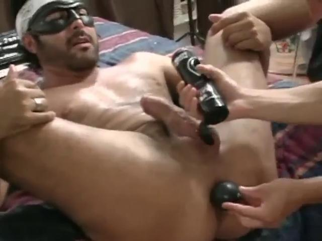 Masked hunky gay gets his tight pest unconvincing beside a unsparing dildo