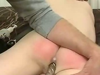 Ballgagged hunk possessions a vibrator put in his ass