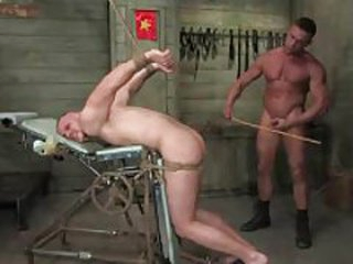 Dude tied up and fucked away from another dude