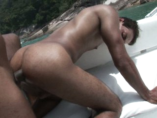 Torrid gays having hard lovemaking in a boat