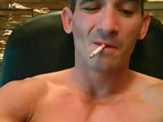 Tatooed tough challenge smokes while strokes his cock